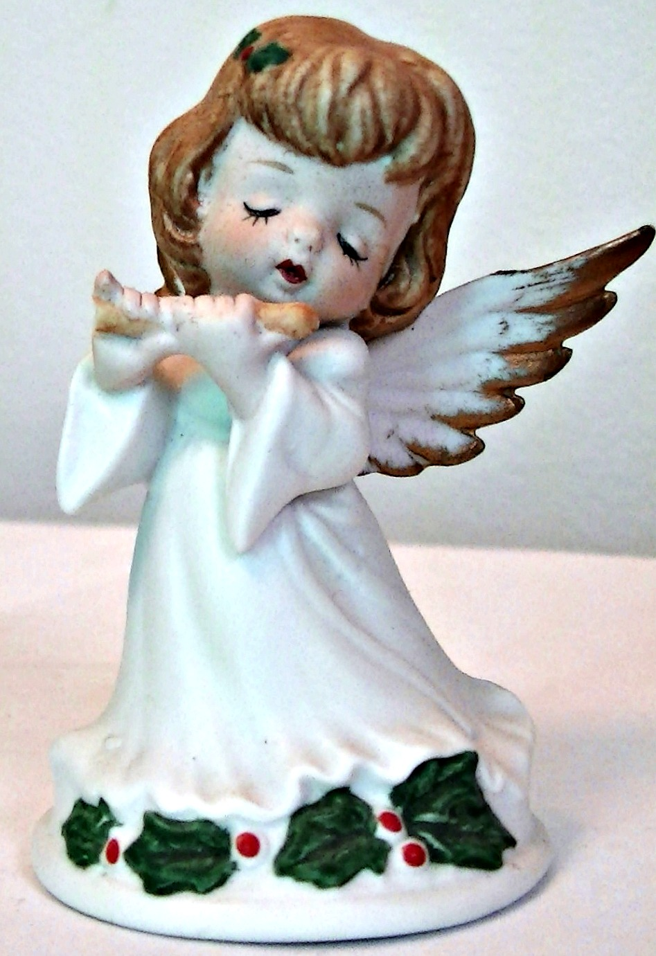 Christmas angel with holly leaves