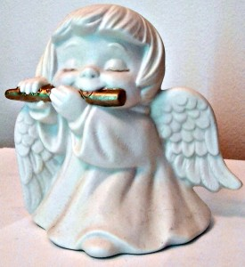 All white angel with gold flute